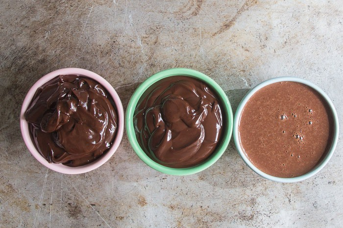 Three bowls of ganache, 1 bowl with 2:1 ratio, 1 bowl with 1:1 ratio, and 1 bowl with 1:1.5 ratio
