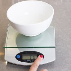 A scale with a bowl on top set to zero