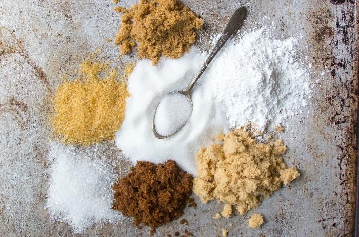 Piles of various types of sugar