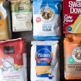 Packages of different types of flour: cake flour, white whole wheat flour, bread flour, whole wheat flour, self-rising flour, all-purpose flour, pastry flour