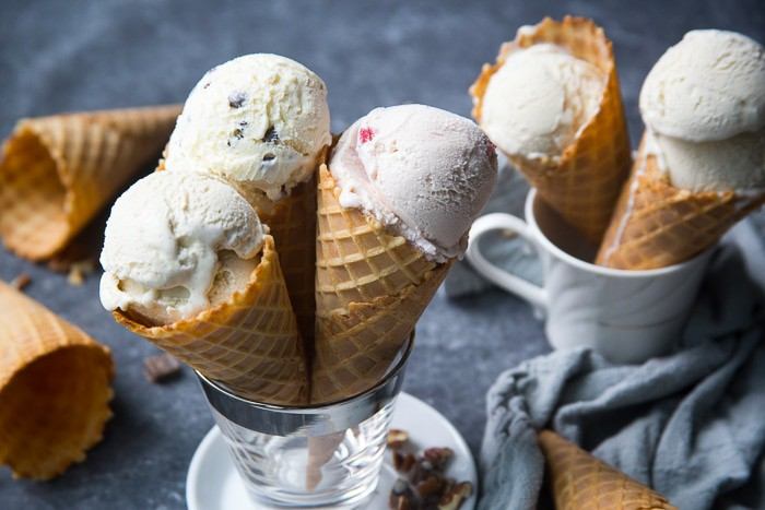 Various flavors of ice cream in waffle cones