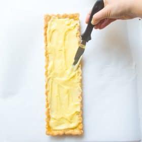 Pastry Cream spread into shortbread crust