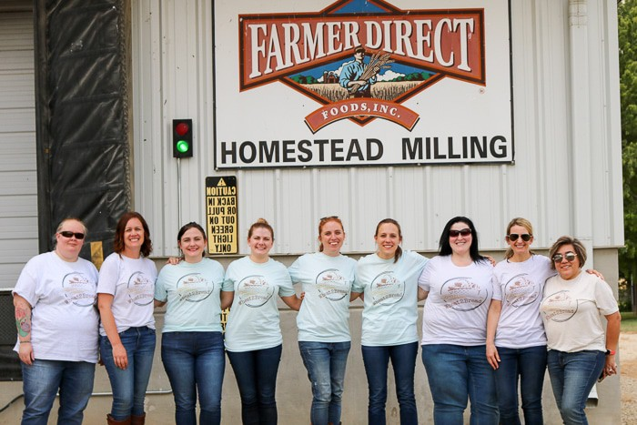 All of us standing in front of a flour mill