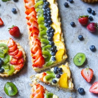 Fruit tart with custard and strawberries, kiwi, blueberries, and peaches