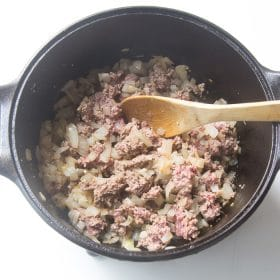 Browning the ground beef with the onions and garlic