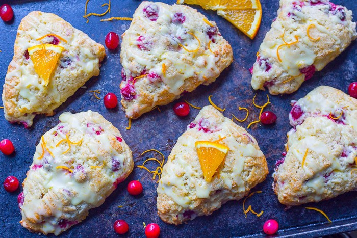 Cranberry Orange Scones with glaze lined up on a tray
