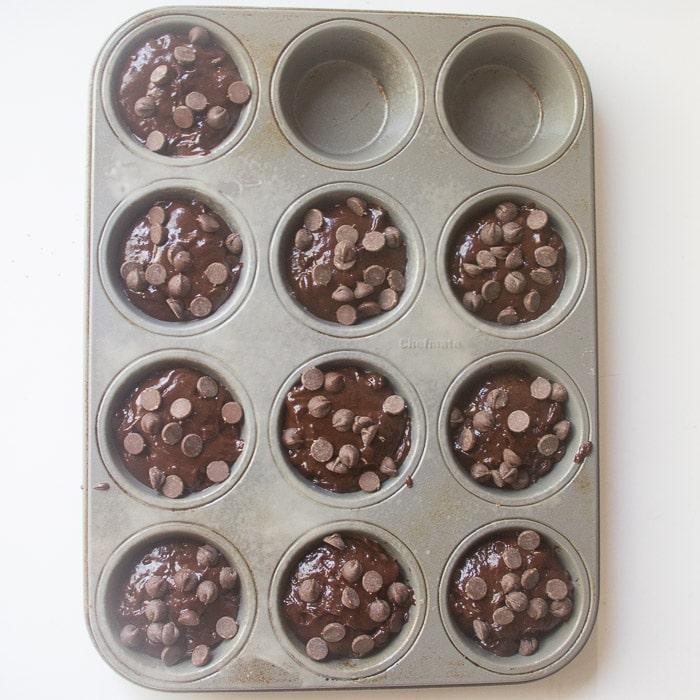 Muffin batter in muffin cups