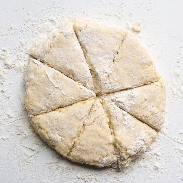 Scone dough in a round shape cut into 8 trianges