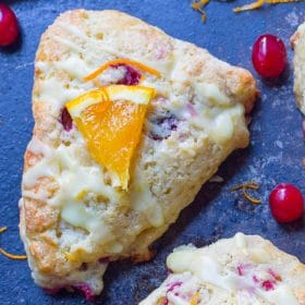 Orange Cranberry scone drizzled with Orange Glaze