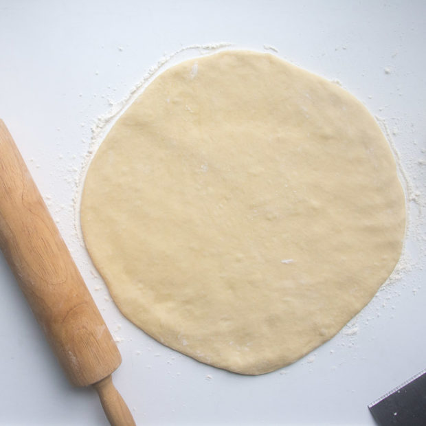 "Dough rolled into a circle 1/4"" thick"