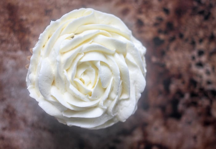 Swiss Meringue Buttercream pipped onto a cupcake in the shape of a rose