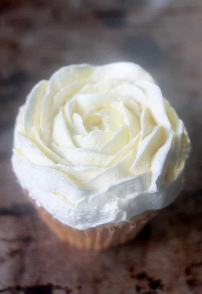 Cupcake iced with Italian Meringue Buttercream into a frosting rose