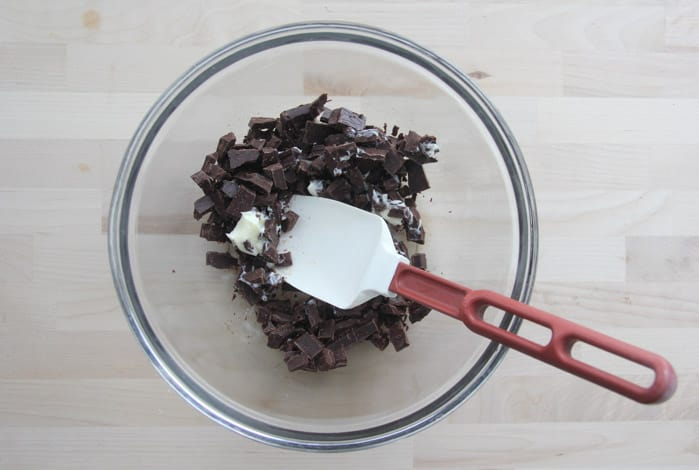 Chopped chocolate in bowl with butter