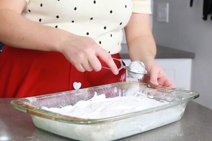 Dusting powdered sugar/cornstarch over marshmallow