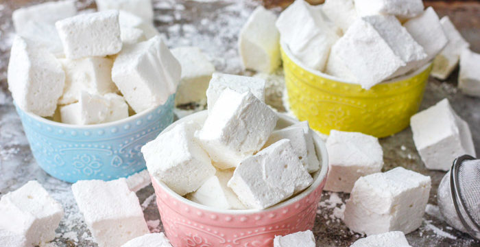Fluffy square homemade marshmallows in various bowls