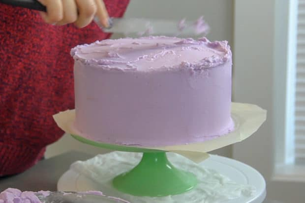 Spreading frosting on the top of the cake