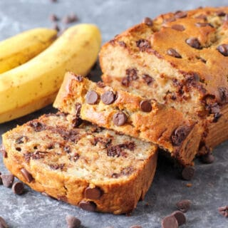 Chocolate chip banana bread sliced with chocolate chips scattered beside it