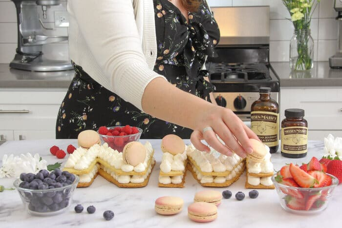 Placing macarons on the cream tart cake