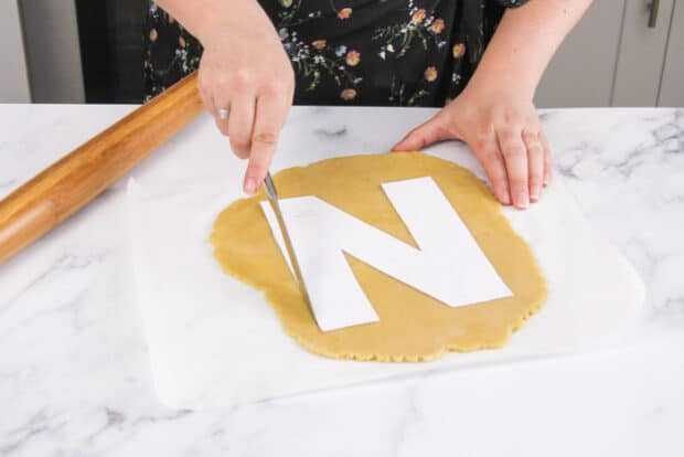 Tracing the letter N out of the tart dough