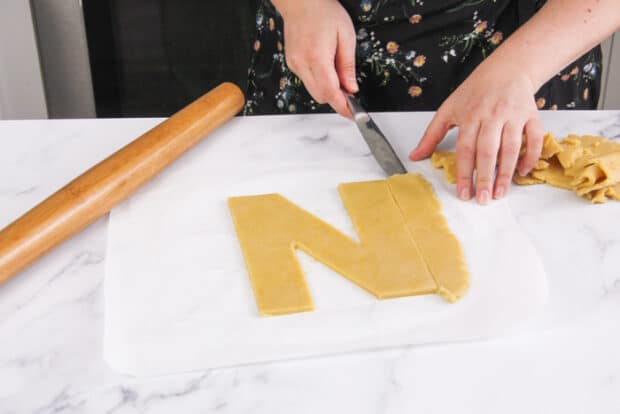 Cutting out the letter N out of the tart dough