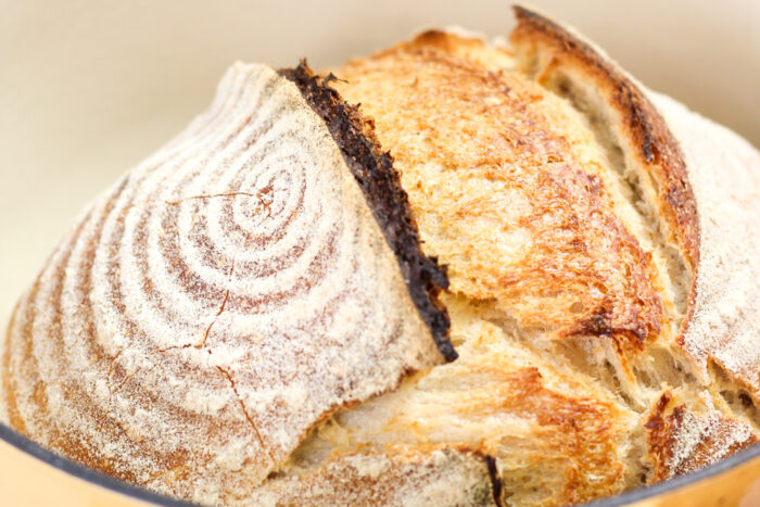 Loaf of sourdough bread in a dutch oven