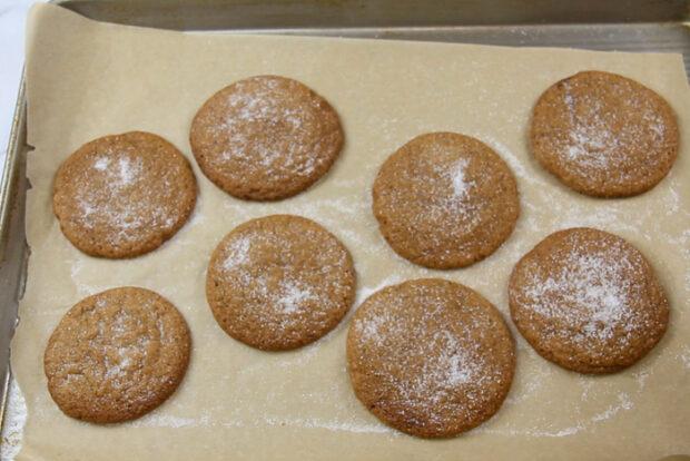 Baking crispy gingersnap cookies on baking sheet