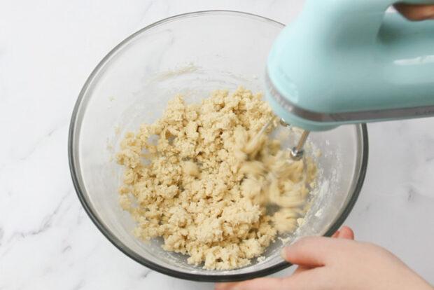 Mixing flour into the pecan snowball dough