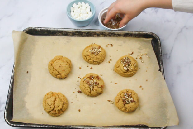 Topping the baked sweet potato cookies with pecans