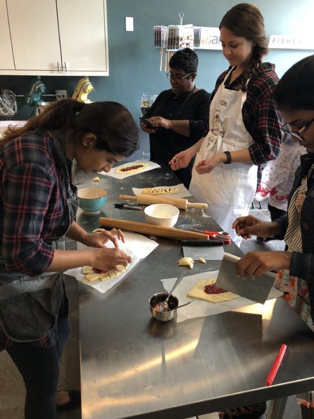 Students working on bread dough during an bread class