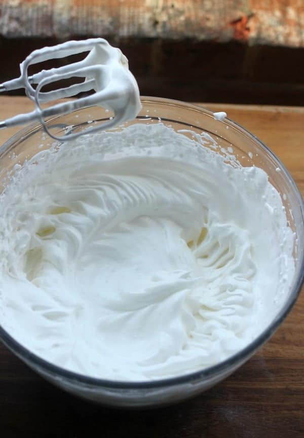 Meringue being whipped with a hand mixer
