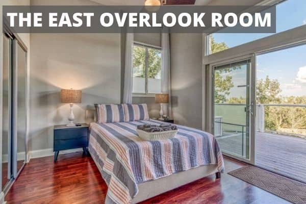 Small bedroom with large bed called the East Overlook Room
