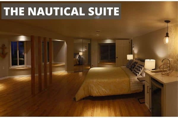 Large bedroom with a large bed called the Nautical Room