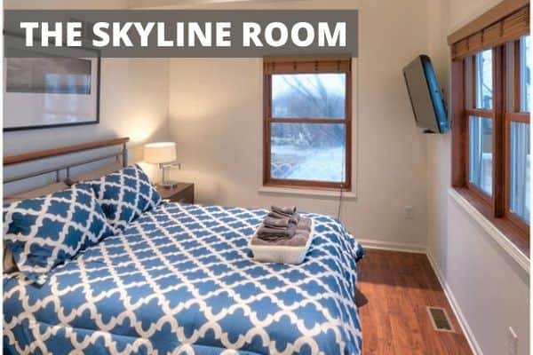 Small bedroom with large bed called the Skyline Room
