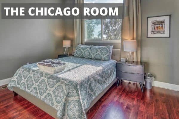 Small bedroom with large bed called the Chicago Room