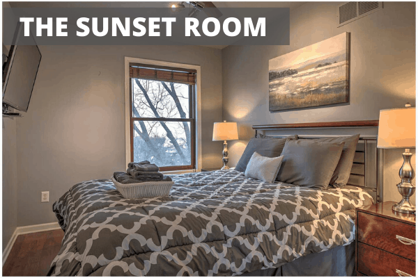 Small bedroom with large bed called the Sunset Room