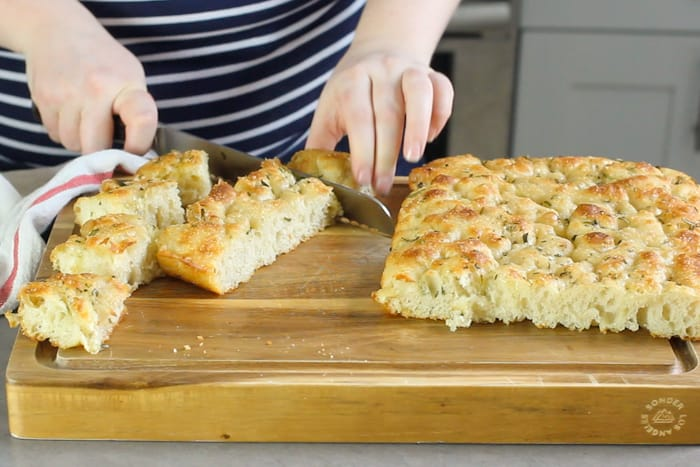 Slicing focaccia into squares