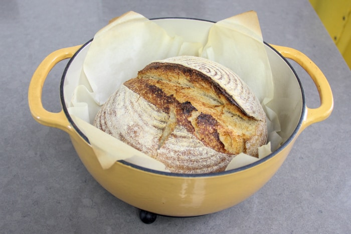 Baked sourdough loaf in a dutch oven