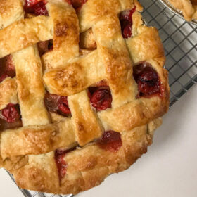 A Berry Apple Pie with lattice crust on top