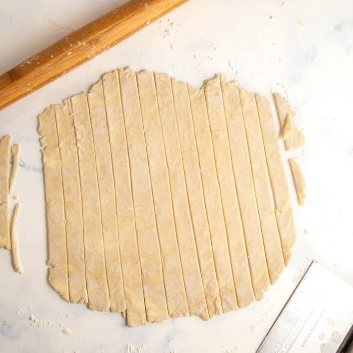 Piece of pie dough rolled out and cut into 1-inch strips