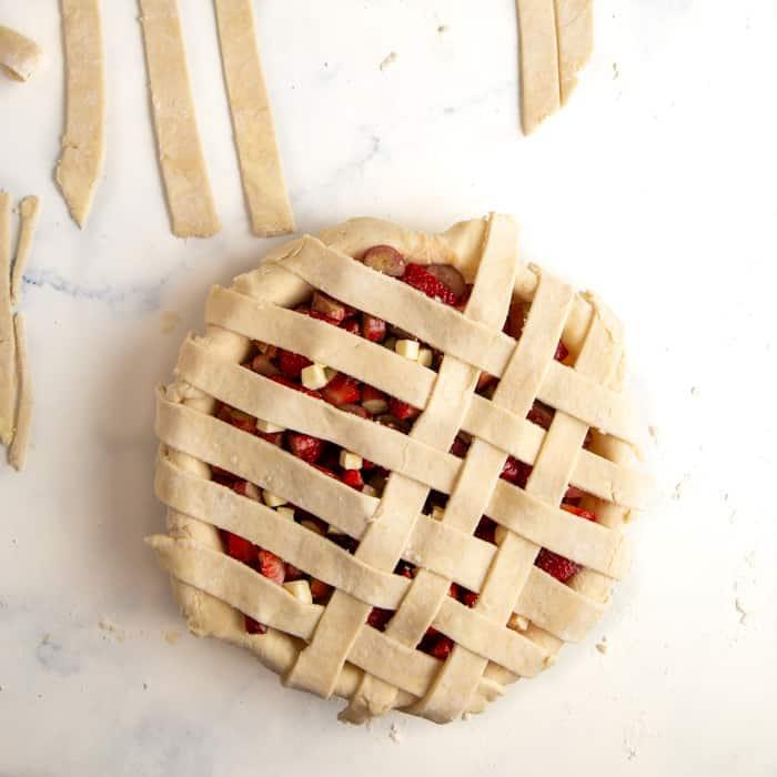 Lattice crust after half has been weaved
