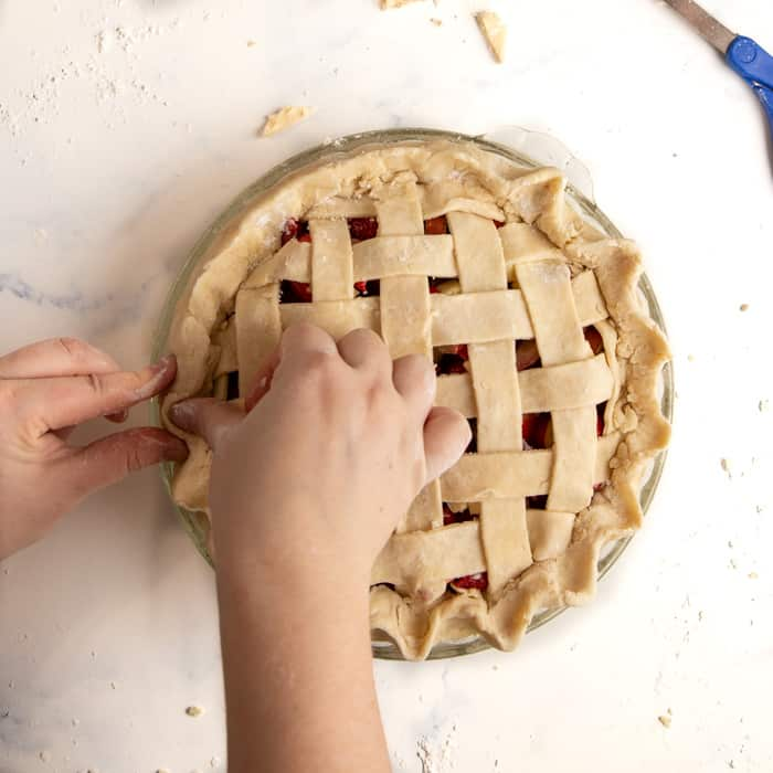Crimping the edges of the crust
