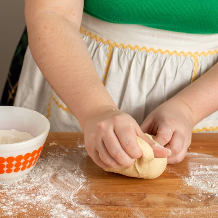 dough on a counter top being kneaded