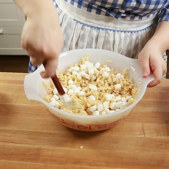 Folding mini marshmallows into rice krispie treat mixture