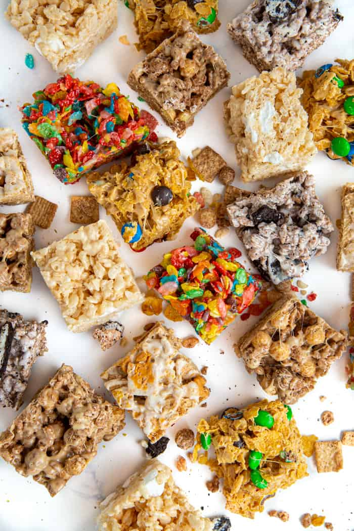 Collage of various flavors of marshmallow cereal treats laid out with pieces of cereal laying around