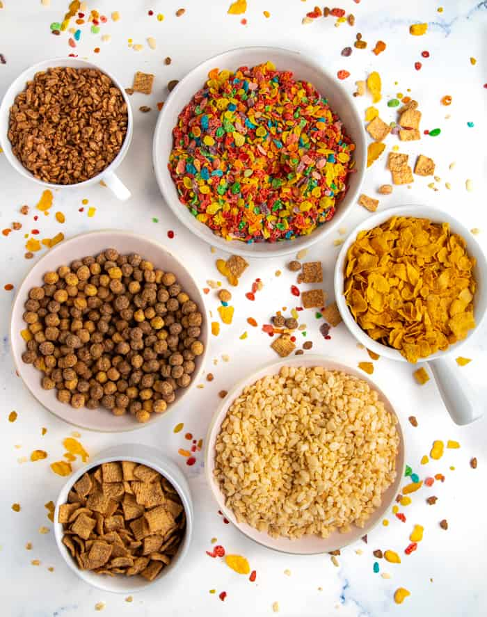 Bowls of cereal including cocoa krispies, fruity pebbles, corn flakes, cocoa puffs, rice krispies, cinnamon toast crunch
