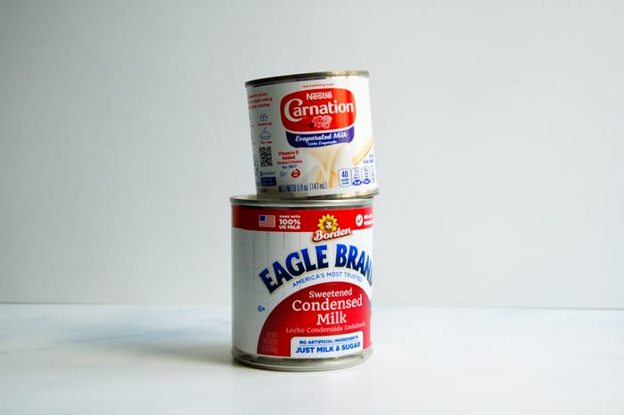 A can of evaporated milk and a can of sweetened condensed milk.
