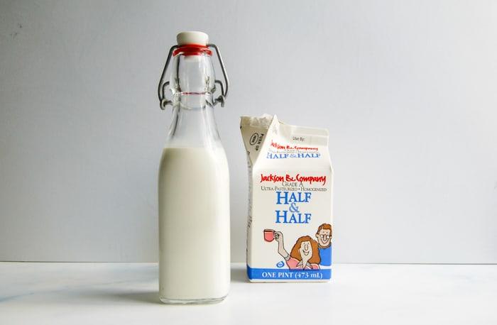 A jar of half and half and the carton.