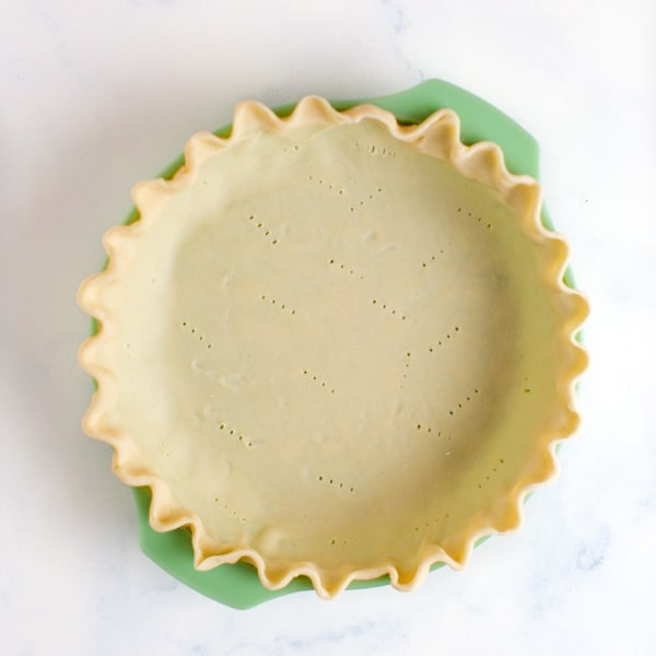 pie crust fit in pie plate that has been crimped and docked