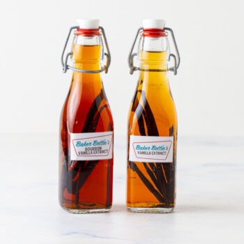 two bottles of homemade vanilla extract side by side