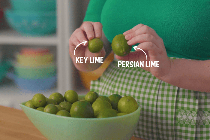 Bowl of limes and someone holding a key lime on the left and a persian lime on the right with text over the image indicated which is which